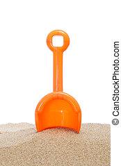 beach shovel in the sand