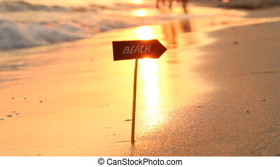 beach sign and Sea Sunset