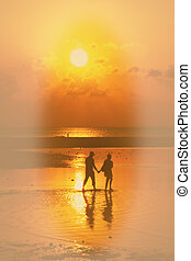 Beach  silhouettes of people relaxing at sunset