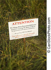 Beach stay off dunes warning sign. - Beach access stay off...