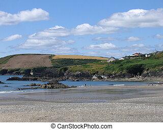 Beach - A beach view with countryside.