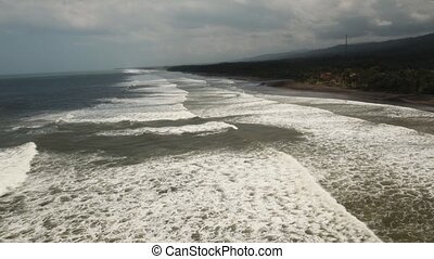 Beach, stormy weather, waves. Bali, Indonesia - Tropical...