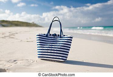 close up of beach bag at seaside
