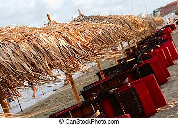 Beach, sun beds, beach umbrellas
