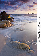 Beach sunset - Sunset on a tranquil beach with Islands on...