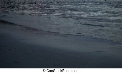 Beach surf in the evening, slow motion video