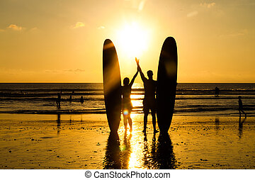 Beach surfer silhouette - Surfer couple in silhouette...