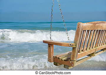 beach swing with ocean surf view
