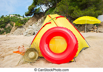 Beach tent with toys and feet