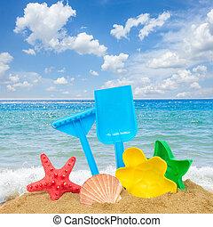 beach toys in sand