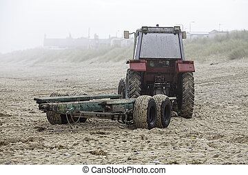 Beach tractor on a misty morning - A red beach tractor with...
