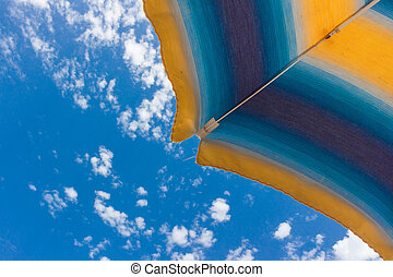 Beach umbrella a on sunny summer day
