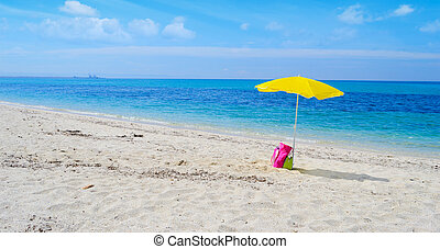 umbrella and bag on a tropical beach