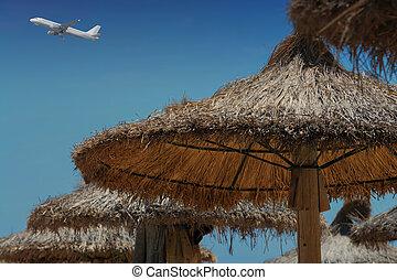 Beach umbrella and commercial aircraft