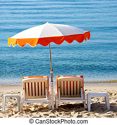 Beach umbrella and lounger square format