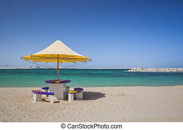 Beach umbrella and seats on the seaside