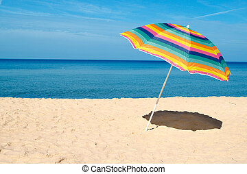 Beach Umbrella - Beach umbrella on a sunny day, sea in...