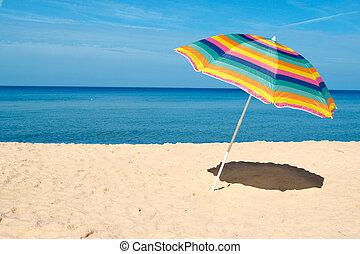 Beach Umbrella - Beach umbrella on a sunny day, sea in...
