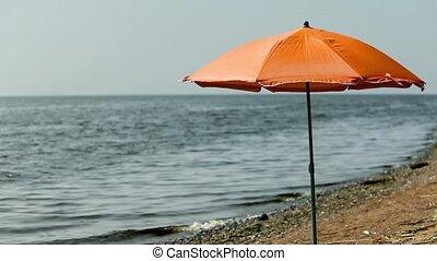 beach umbrella on an empty beach