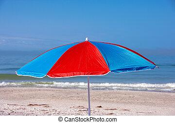 beach umbrella on seashore