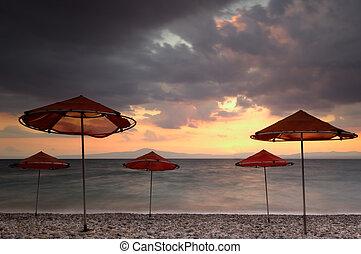 Beach umbrellas on a windy day