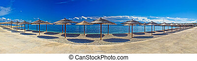 Beach umbrellas panoramic view, Vir island