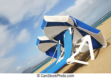 Beach Umbrellas - Beach umbrellas and loungers