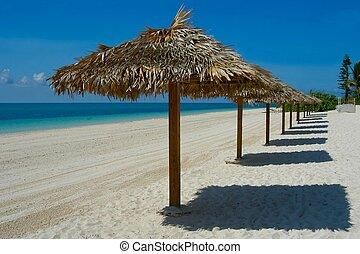 Beach umbrellas in Freeport beach, Bahamas islands