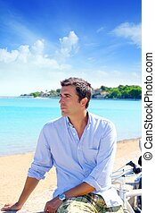 beach vacation man looking the sea blue shirt