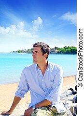 beach vacation man looking the sea blue shirt