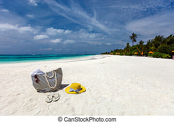Beach vacation - Straw hat, bag, sun glasses and flip flops...