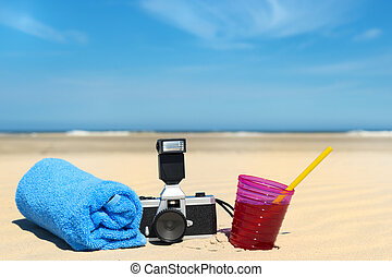 Beach vacation - Vacation with photo camera and towel at the...