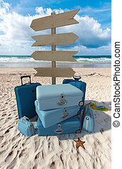 Beach vacations directions - Pile of luggage and directional...