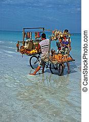 Beach Vendor - a Local selling souvenirs on the beach