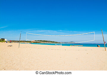 beach volley net and rubber boats in Porto Pollo