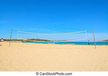 beach volley net and surfboards