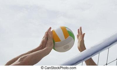Beach volleyball game closeup spike and block - Beach ...
