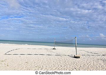 Beach volleyball net on eagle beach with blue oceans