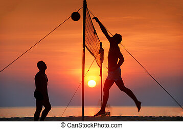 beach volleyball - silhouette play beach volleyball. Sunset...