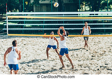 Beach Volleyball Players during Game