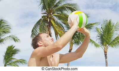 Beach volleyball sport in summer. Man setting volley ball in layup. Friends playing outdoors in summer. People having fun recreational game living healthy active lifestyle. RED EPIC.