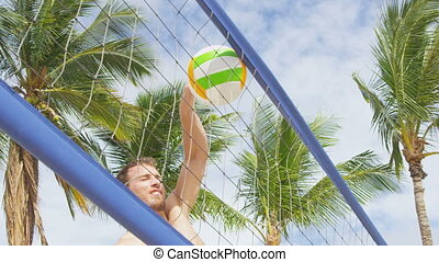 Beach volleyball sport in summer. Man failing spiking volley ball in hard spike jump smash error. People having fun recreational game living healthy active lifestyle.