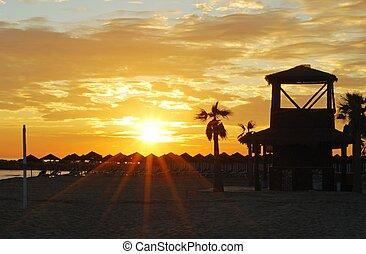 Beach & watchtower at sunset.