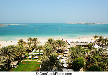 Beach with a view on Jumeirah Palm man-made island, Dubai,...