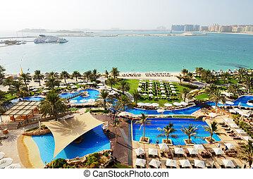 Beach with a view on Jumeirah Palm man-made island, Dubai,...