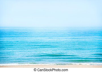 Beach with blue sea and sky