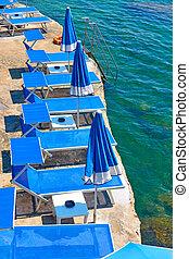 Beach with blue sunbeds