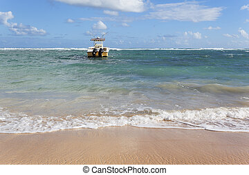 beach with boat on the sea and blue sky
