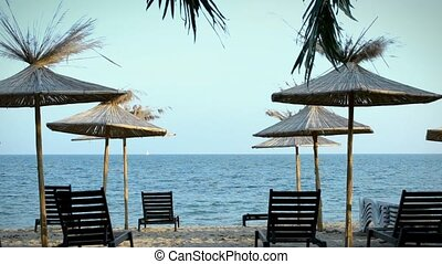 Beach with chaise-longue - Seaview panorama with blue sky...