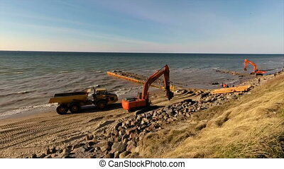 beach with construction work to shore safe from flooding and sand erosion in storm